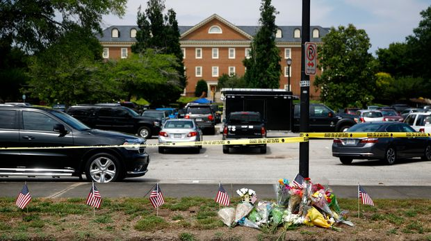 A makeshift memorial rests at the edge of a police cordon in front of a municipal building that was the scene of a shooting, Saturday, June 1, 2019, in Virginia Beach, Va. DeWayne Craddock, a longtime city employee, opened fire at the building Friday before police shot and killed him, authorities said. (AP Photo/Patrick Semansky)