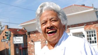 Chef Leah Chase stands outside her famous Creole restaurant, Dookie Chase's, which was flooded out during Hurricane Katrina, Friday, March 9, 2007, in New Orleans. (AP Photo/Cheryl Gerber)