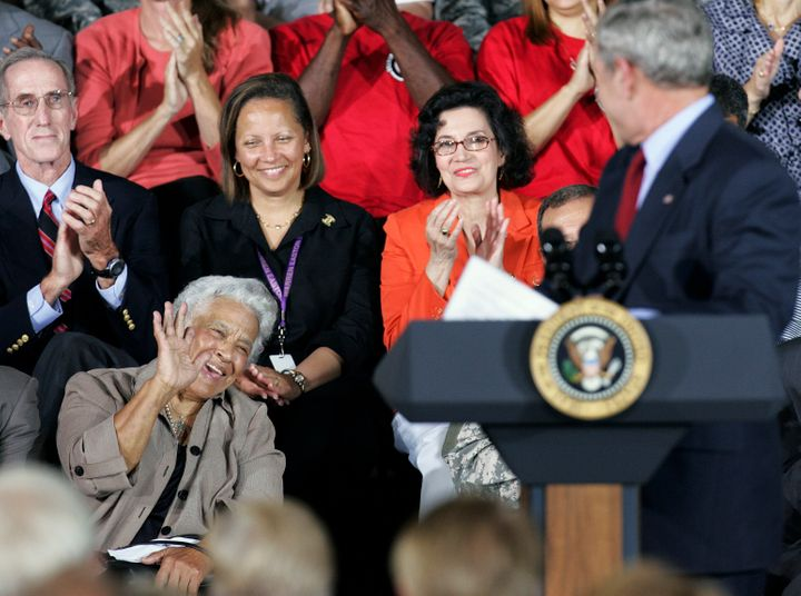 New Orleans chef Leah Chase waves to President Bush as the president acknowledges her during a speech at Jackson Barracks, wh