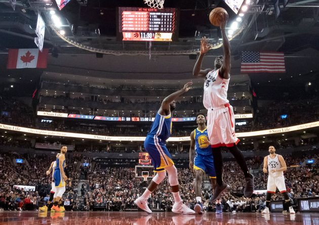 Pascal Siakam of the Raptors, right, drives to the basket against the Golden State Warriors during Game...