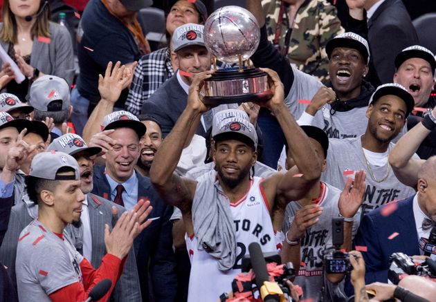 Kawhi Leonard holds up a trophy after the Toronto Raptors win the Eastern Conference