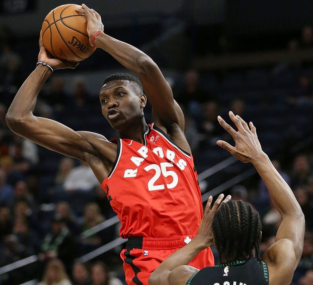 Toronto Raptors' Chris Boucher passes the ball away from Minnesota Timberwolves' Andrew Wiggins during...
