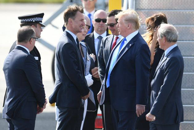 President Donald Trump talks to Foreign Secretary Jeremy Hunt at London's Stansted Airport on Monday