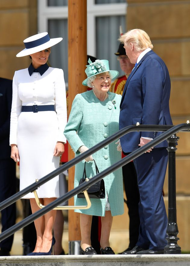 Melania Trump, the Queen, and Donald Trump, speak before observing a Guard of Honour at Buckingham Palace.The...