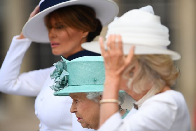 Blustery conditions saw Melania Trump and Camilla, Duchess of Cornwall, hold onto their hats.Camilla...