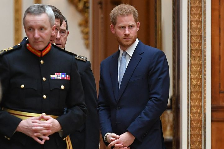 Prince Harry looks on as Donald Trump and his entourage of family and close aides toured the Royal Collection.