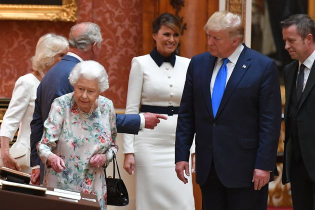 The Queen shows President Trump an exhibit during a tour of the Royal Collection at Buckingham