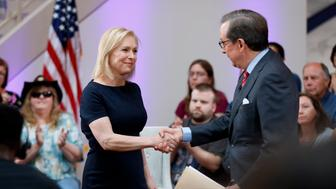 Democratic presidential candidate Sen. Kirsten Gillibrand greets FOX News Anchor Chris Wallace, right, as she arrives at a FOX News town hall, Sunday, June 2, 2019, in Dubuque, Iowa. (AP Photo/Charlie Neibergall)