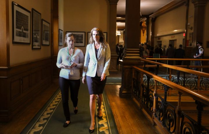 Attorney General Caroline Mulroney with her assistant on Sept. 13, 2018 at Queen's Park in Toronto. She has overseen the cuts to Legal Aid Ontario.