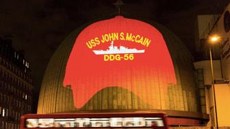 USS John McCain hat projected onto Madame Tusseaud's