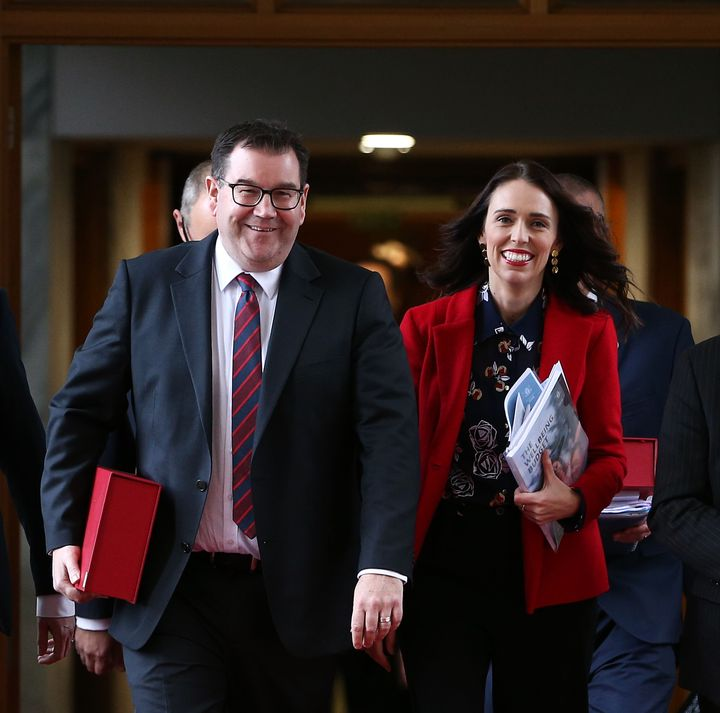 Finance minister Grant Robertson and prime minister Jacinda Ardern walk to the house during the 2019 budget presentation at Parliament on May 30, 2019, in Wellington, New Zealand.