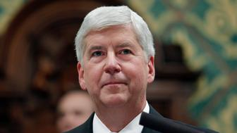 In this Jan. 23, 2018, former Michigan Gov. Rick Snyder delivers his State of the State address at the state Capitol in Lansing, Mich. In his final days in office, Snyder erased the felony drunken-driving conviction of Jim Jagger who pleaded for a pardon so he could seek a lucrative promotion as the next president of the Michigan Association of Certified Public Accountants.  (AP Photo/Al Goldis)