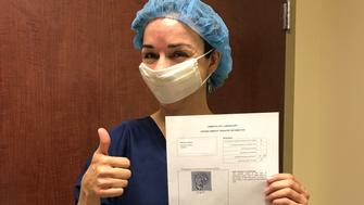 My gestational carrier took this picture of me ecstatically holding an image of the male embryo before the transfer.