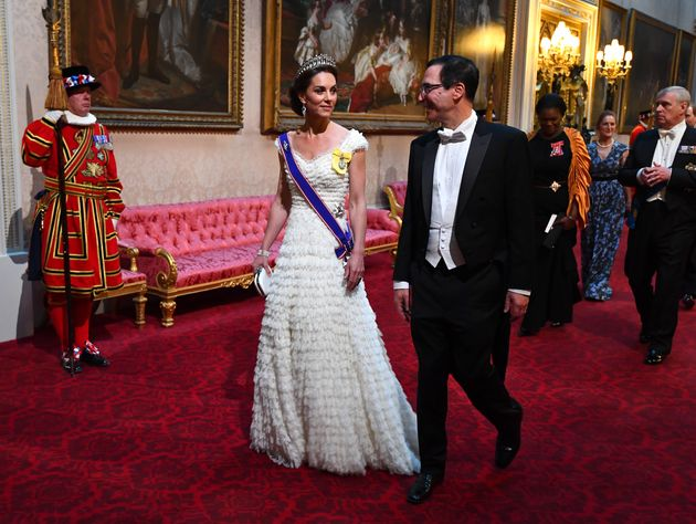 The Duchess of Cambridge and United States Secretary of the Treasury, Steven Mnuchin arrive through the...