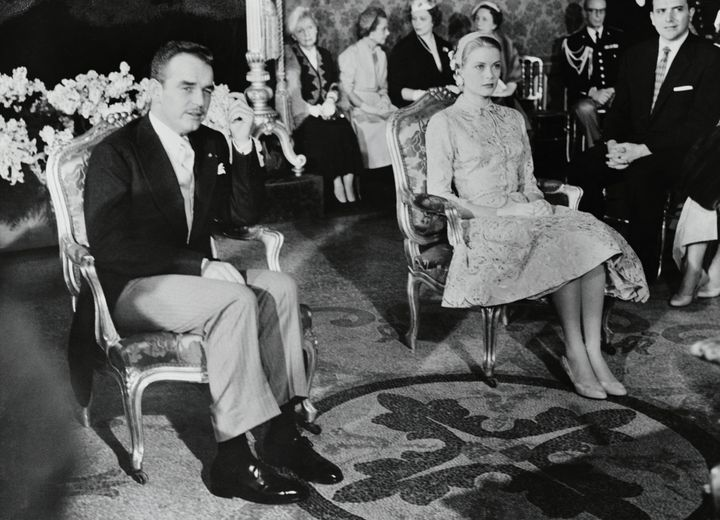 Grace, in a brocade skirt and jacket ensemble, pictured with Rainier at their civil wedding ceremony on April 18, 1956. The religious ceremony took place the following day.