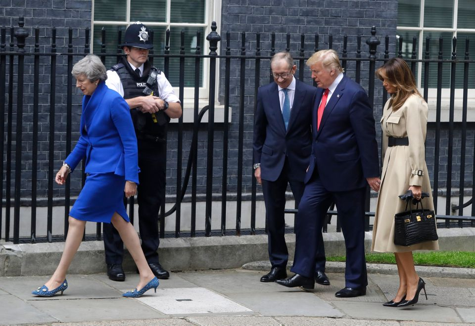 Prime Minister Theresa May and her husband Philip greet Donald Trump and first lady Melania outside 10...