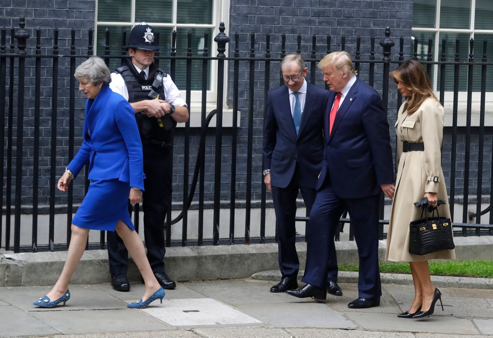 Prime Minister Theresa May and her husband Philip greet Donald Trump and first lady Melania outside 10 Downing Street in cent