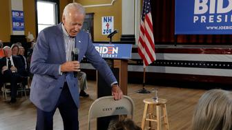 Former vice president and Democratic presidential candidate Joe Biden brings a chair over for a woman in the audience during a campaign event, Tuesday, June 4, 2019, in Berlin, N.H. (AP Photo/Elise Amendola)