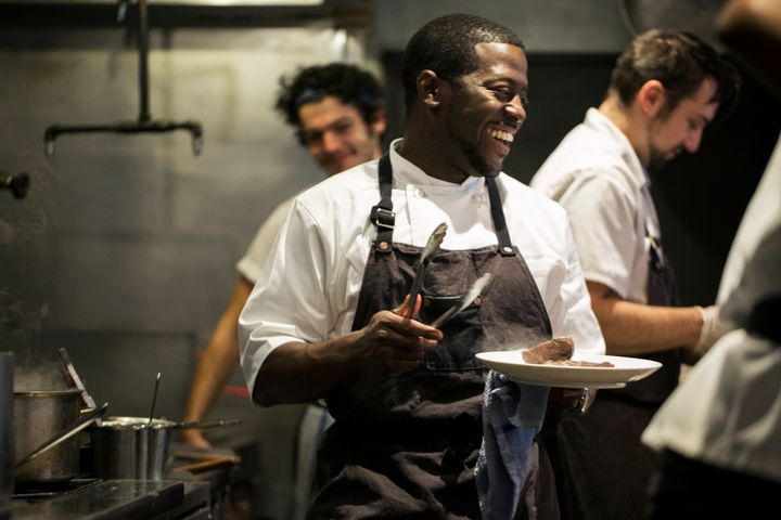 Chef Edouardo Jordan works the line at one of his Seattle restaurants, Salare.