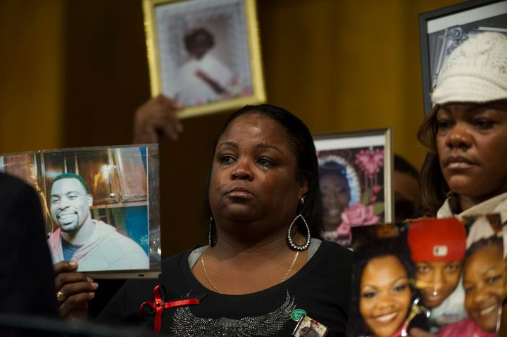 Antionette Johnson, of Oakland, California, holds a photo of her son Terrell Reams, 23, who was shot and killed in Oakland, a
