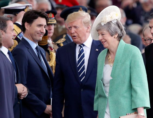 Prime Minister Justin Trudeau, U.S. President Donald Trump and British Prime Minister Theresa May attend...