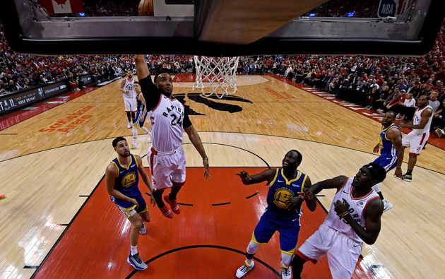 Toronto Raptors forward Norman Powell (24) shoots the ball against Golden State Warriors forward Draymond...