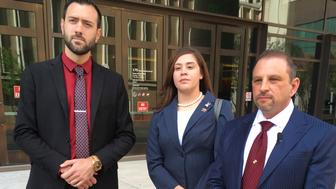 File - In this March 29, 2018, file photo, 32-year-old Tahnee Gonzales, of Glendale, Ariz., stands with her attorneys Marc Victor, right, and Andrew Marcantel, left, outside of the courthouse in downtown Phoenix. Gonzales, captured on video making derogatory comments about Muslims as she and a friend lifted Qurans and other items from an Arizona mosque, was sentenced Tuesday, June 4, 2019, to two years of probation for an aggravated criminal damage conviction. (AP Photo/Jacques Billeaud, File)