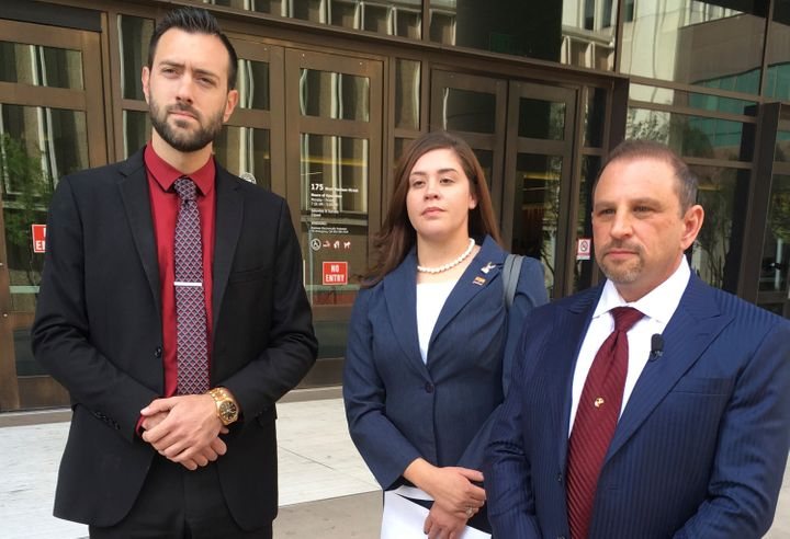 Tahnee Gonzales stands with her attorneys Marc Victor (right) and Andrew Marcantel outside the courthouse in downtown Phoenix
