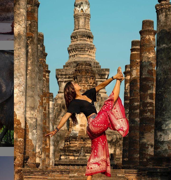 Yoga instructor Andreita Levin posing at Sukhothai Historical Park.