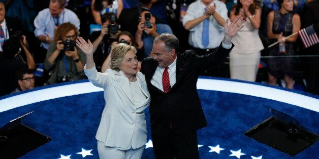 Democratic presidential nominee Hillary Clinton waves with her vice presidential running mate Senator Tim Kaine after accepti