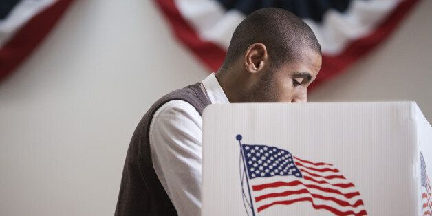 Hispanic voter voting in polling place