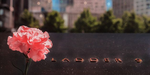 United States of America, New York City, Lower Manhattan, Groun Zero , September 11 Memorial.A view of a rose placed at the S
