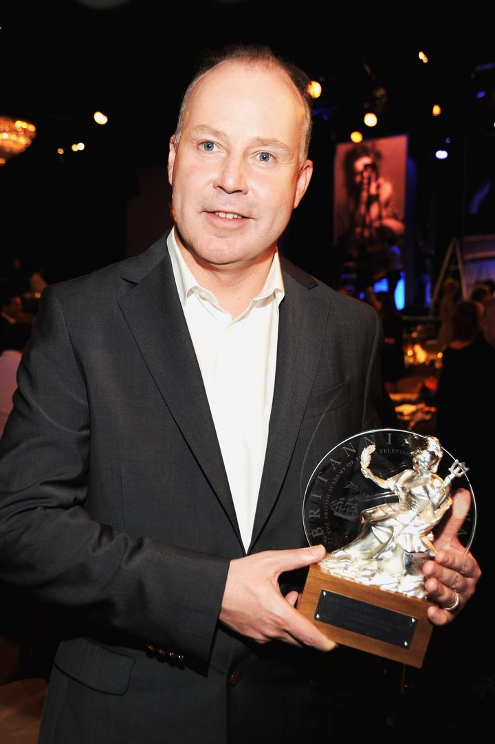 BEVERLY HILLS, CA - NOVEMBER 30:  Honoree David Yates poses with the John Schlesinger Britannia Award for Artistic Excellence