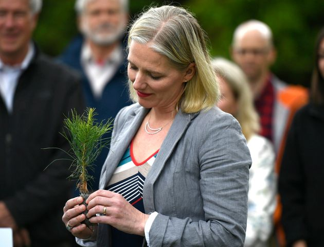 Minister of Environment and Climate Change Catherine McKenna holds a sapling on Wednesday, June 5,