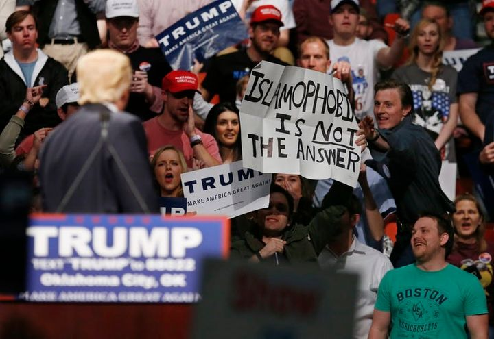 At a 2016 Trump rally, a man holds up a sign, 'Islamophobia is not the answer.'
