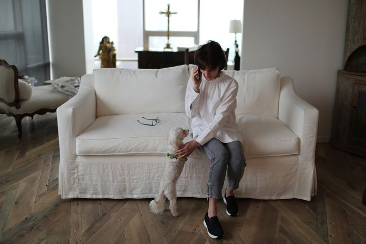 Laura Pontikes talks on the phone in her apartment in Houston on April 13, 2019.