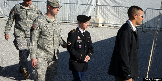 FORT MEADE, MD - JUNE 06: U.S. Army Private Bradley Manning (2nd R) is escorted during his arrival to military court on the f