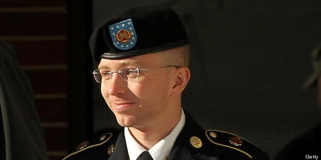 FORT MEADE, MD - OCTOBER 17: U.S. Army private first class Bradley Manning is escorted away after a hearing on the witness list of a speedy trial motion October 17, 2012 at Fort Meade in Maryland. Manning is charged with aiding the enemy and transmitting defense records, plus other counts, after he was accused of passing classified documents to the whistleblower website WikiLeaks. (Photo by Alex Wong/Getty Images)