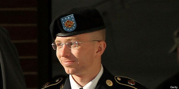 FORT MEADE, MD - OCTOBER 17:  U.S. Army private first class Bradley Manning is escorted away after a hearing on the witness l