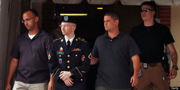 FORT MEADE, MD - JULY 25:  U.S. Army Private First Class Bradley Manning (2nd L) is escorted by military police as he leaves