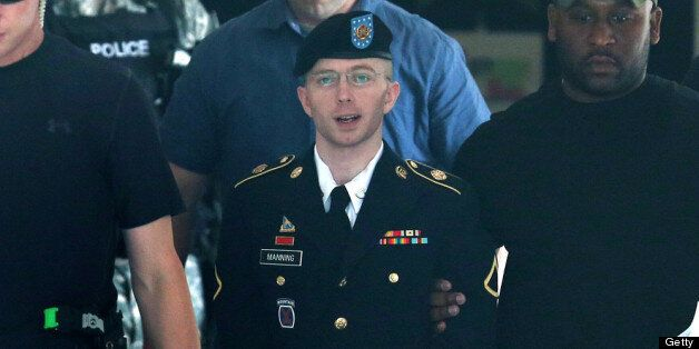 FORT MEADE, MD - JULY 30:  U.S. Army Private First Class Bradley Manning (C) is escorted by military police as he leaves his