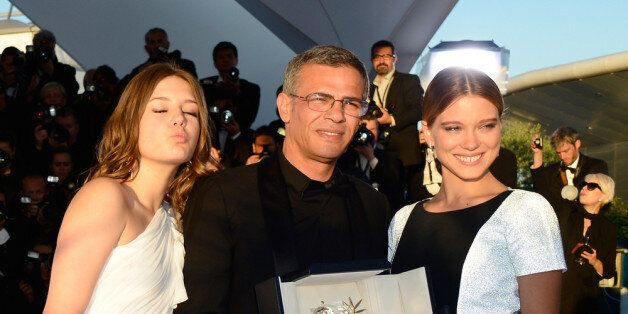 CANNES, FRANCE - MAY 26:  (L-R) Actress Adele Exarchopoulos, Director Abdellatif Kechiche and Lea Seydoux pose with the 'Palm