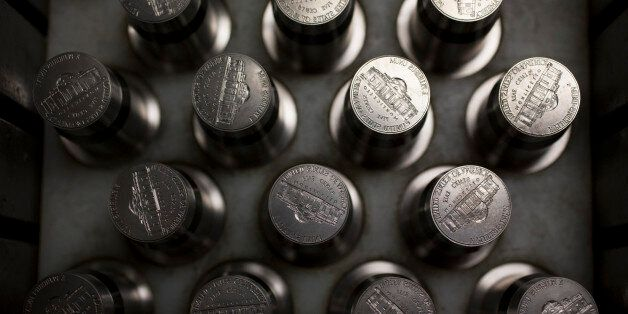 Dies used for pressing nickels sit in a tray at the U.S. Mint in Philadelphia, Pennsylvania, U.S., on Wednesday, July 17, 201