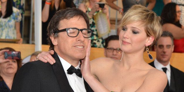 LOS ANGELES, CA - JANUARY 18:  Director David O. Russell (L) and actress Jennifer Lawrence attend the 20th Annual Screen Acto