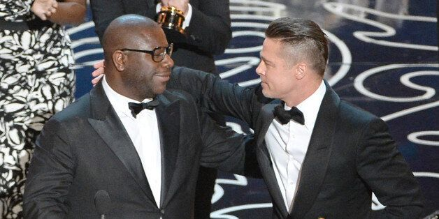 HOLLYWOOD, CA - MARCH 02:  Director Steve McQueen (L) and actor/producer Brad Pitt accept the Best Picture award for '12 Year