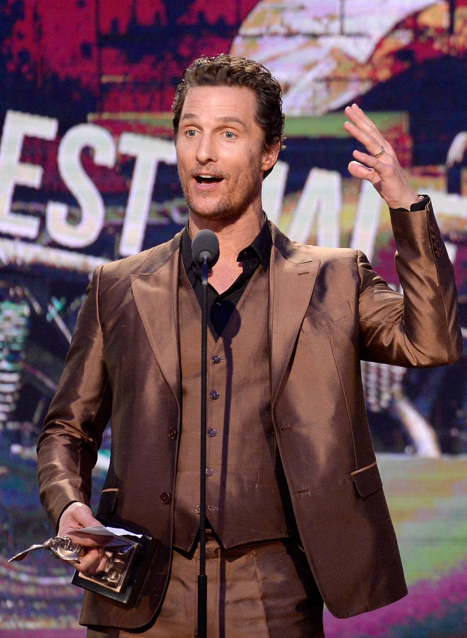 SANTA MONICA, CA - MARCH 01:  Actor Matthew McConaughey accepts the Best Male Lead award for 'Dallas Buyers Club' onstage dur
