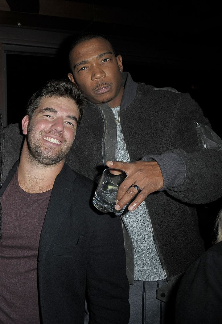 Ja Rule and Billy McFarland together at an event.