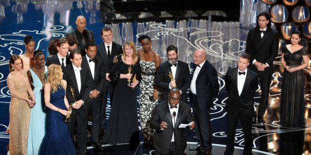 HOLLYWOOD, CA - MARCH 02:  Director Steve McQueen (C) accepts the Best Picture award for '12 Years a Slave' with (back row) a