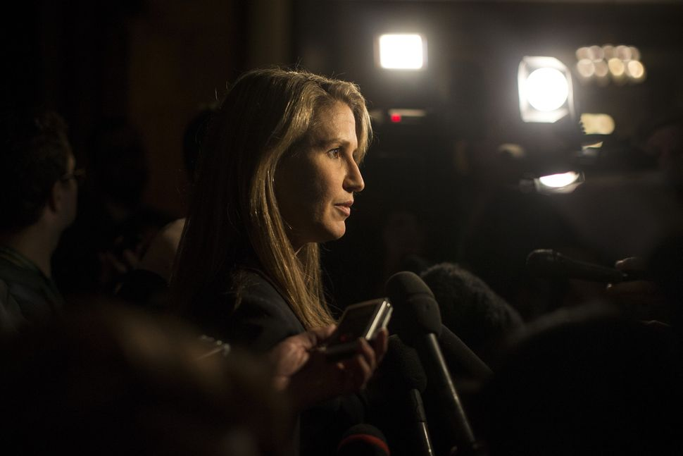 Ontario's Attorney General Caroline Mulroney speaks to journalists at Queen's Park in Toronto on March...