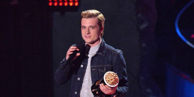 LOS ANGELES, CA - APRIL 13:  Actor Josh Hutcherson speaks onstage at the 2014 MTV Movie Awards at Nokia Theatre L.A. Live on